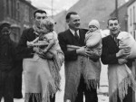 Men in Blaenrhondda carrying babies in shawls Welsh fashion, vintage slingdads